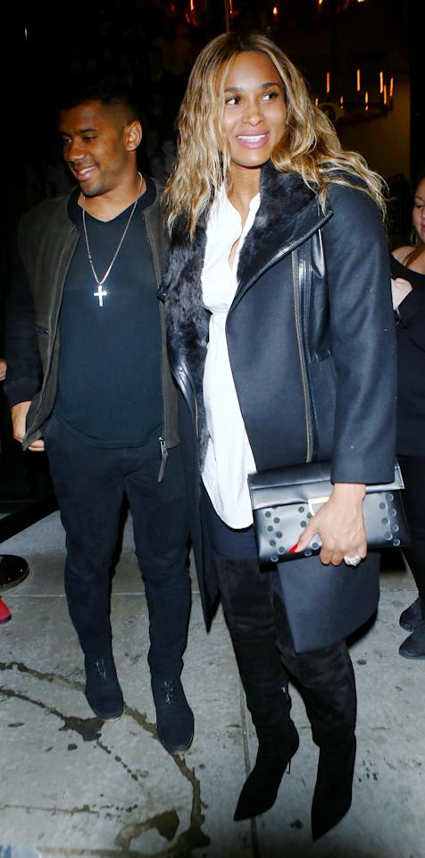 <p>To step out with husband Russell Wilson to L.A. celebrity hotspot Catch, the expectant star donned jeans, over-the-knee boots, a white top from A Pea in a Pod, and a leather jacket.</p>