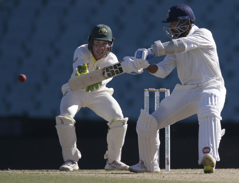 India's M. Vijay, right, bats in an over where he scores 26 runs during their tour cricket match against Cricket Australia XI in Sydney, Saturday, Dec. 1, 2018. (AP Photo/Rick Rycroft)