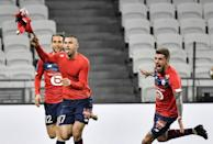 Burak Yilmaz (C) scored twice in the 3-2 win over Lyon as Lille recovered from two goals down