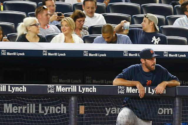 <p>Kate Upton attends the game against the New York Yankees as Justin Verlander looks on from the bench at Yankee Stadium on August 4, 2014 in the Bronx borough of New York City. (Photo by Mike Stobe/Getty Images) </p>