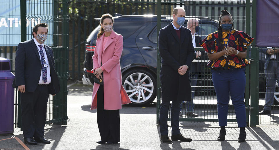 Britain's Prince William and Kate, Duchess of Cambridge arrive for a visit to School21, a secondary schools in east London, Thursday March 11, 2021. Prince William has defended Britain's monarchy against accusations of bigotry made by his brother, Prince Harry, and his sister-in-law, Meghan, insisting the family is not racist. In comments made during a visit Thursday to an east London school, William became the first royal to directly address the explosive interview his brother and Meghan gave to Oprah Winfrey. Buckingham Palace sought to respond to Harry and Meghan's allegations of racism and mistreatment in a 61-word statement, but it has failed to quell the controversy. (Justin Tallis/Pool via AP)