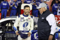 Car owner Rick Hendrick, right, congratulates Kyle Larson in victory lane after Larson won the NASCAR Cup Series auto race at Charlotte Motor Speedway in Concord, N.C., late Sunday, May 30, 2021. (AP Photo/Nell Redmond)