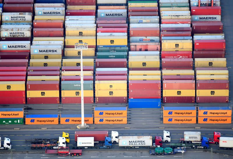FILE PHOTO: Containers of Maersk, MSC and Hapag-Lloyd are seen at a terminal in the port of Hamburg