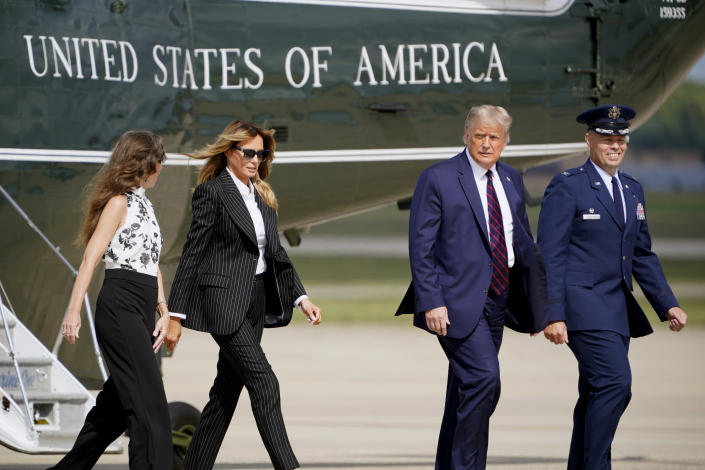 President Donald Trump and first lady Melania Trump walk to board Air Force One to travel to the first presidential debate in Cleveland, Tuesday, Sept. 29, 2020, in Andrews Air Force Base, Md. (AP Photo/J. Scott Applewhite)