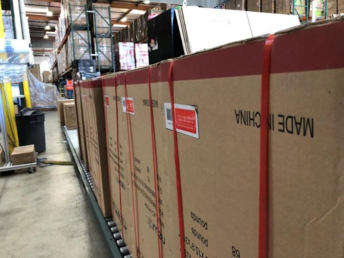 FILE PHOTO: Boxes marked 'Made in China' are lined up in NewAir's warehouse in Cypress