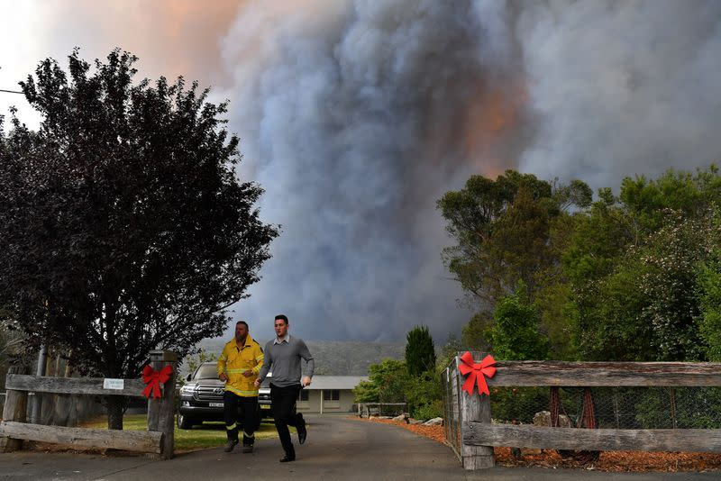 RFS crews engage in property protection of a number of homes along the Old Hume Highway as the Green Wattle Creek Fire threatens a number of communities in the southwest of Sydney