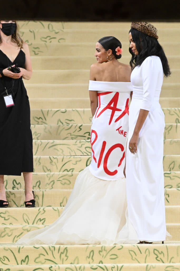 Alexandria Ocasio-Cortez with Aurora James in a custom Brother Vellies gown. - Credit: AP Images