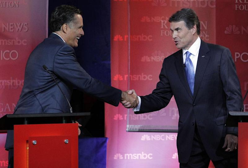 Republican presidential candidates former Massachusetts Gov, Mitt Romney, left, and Texas Gov. Rick Perry shake hands at the finish of a Republican presidential candidate debate at the Reagan Library Wednesday, Sept. 7, 2011, in Simi Valley, Calif.  (AP Photo/Jae C. Hong)