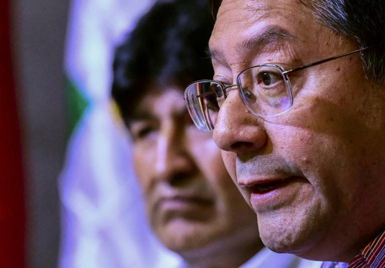 Bolivia's MAS party candidate Luis Arce (R) told a news conference in Buenos Aires Arce, the candidate for Morales's Movement for Socialism party, said he would return to Bolivia from exile in Mexico to begin campaigning (AFP Photo/RONALDO SCHEMIDT)