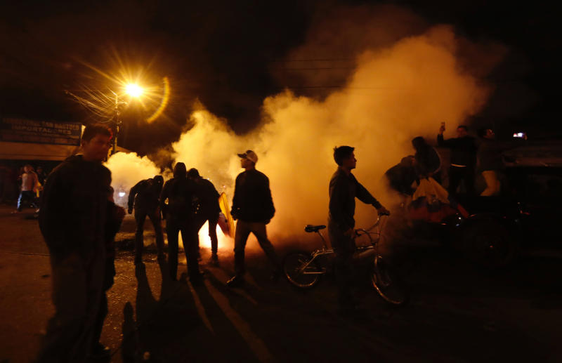 Anti-government protesters block a street where they set tires on fire in Quito, Ecuador, Monday, Oct. 7, 2019. Ecuador has endured days of popular upheaval since President Lenín Moreno scrapped fuel price subsidies, a step that set off protests and clashes across the small South American country. (AP Photo/Dolores Ochoa)