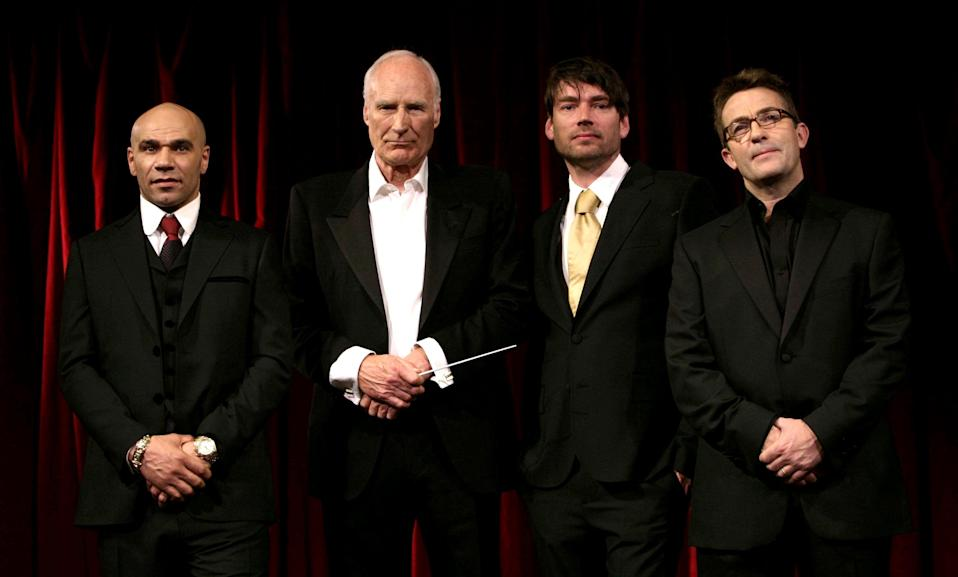 The four male contestants (minus David Soul, who did not attend) (from left to right) Goldie, Peter Snow, Alex James and Bradley Walsh during a photocall to launch BBC Two's 'Maestro' - where eight celebrity amateurs will compete for the chance to conduct the BBC Concert Orchestra in front of a live audience of 30,000 at Proms in the Park - at the Criterion Theatre in central London. (Photo by Yui Mok - PA Images/PA Images via Getty Images)