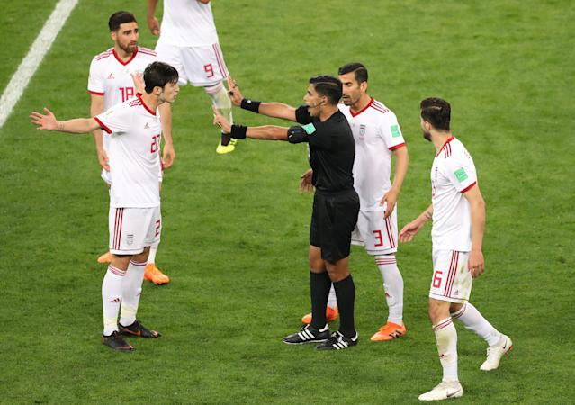 Soccer Football - World Cup - Group B - Iran vs Portugal - Mordovia Arena, Saransk, Russia - June 25, 2018 Iran's Sardar Azmoun and Ehsan Hajsafi remonstrate with referee Enrique Caceres REUTERS/Lucy Nicholson