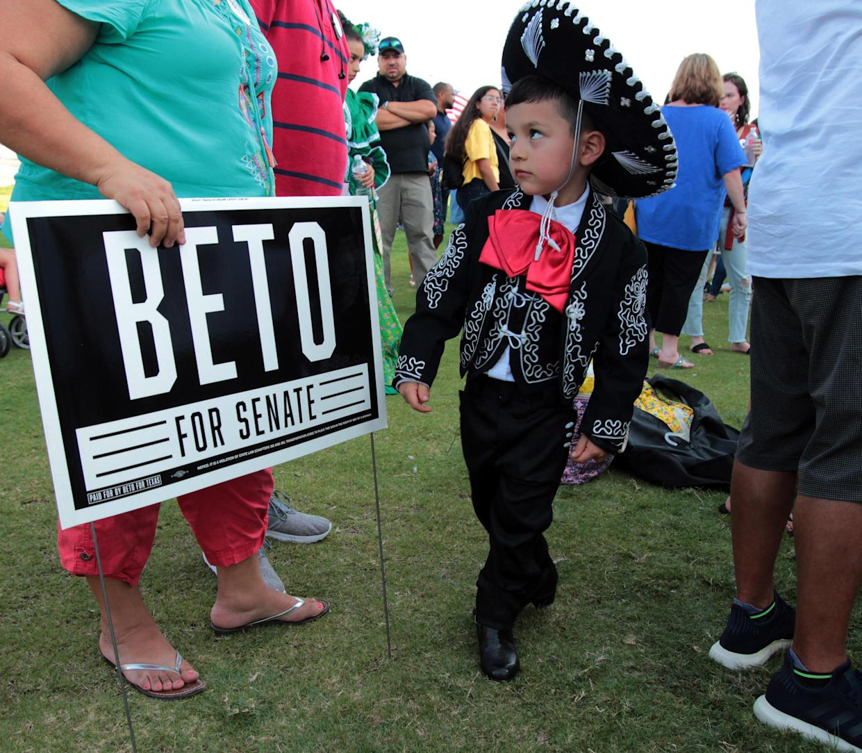 Ballet Folklorico de Fort Worth member Vicente Bonilla, 4, of Fort Worth dances even while offstage at a rally for Beto O'Rourke in August in Fort Worth, Texas. (Photo: Ian McVea/Fort Worth Star-Telegram/TNS)
