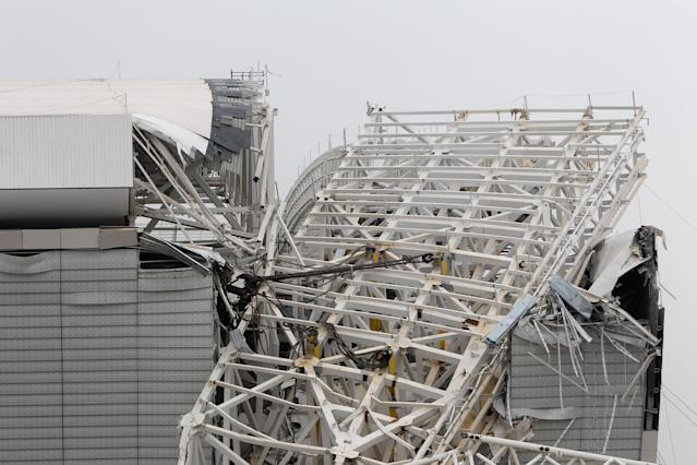 SAO PAULO, BRAZIL - NOVEMBER 27: A crane collapsed during construction at Itaquerao Stadium on November 27, 2013 in Sao Paulo, Brazil. According to reports, at least two workers were killed in the accident. The stadium is scheduled to host the opening ceremony of the World Cup in 2014. (Photo by Ricardo Bufolin/Getty Images)