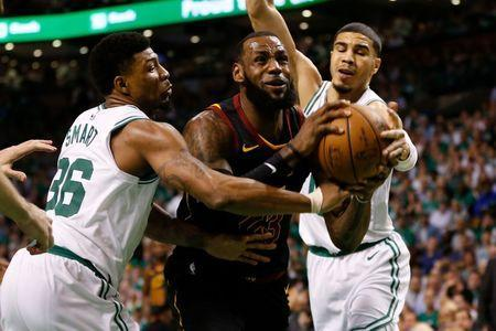 May 23, 2018; Boston, MA, USA; Cleveland Cavaliers forward LeBron James (23) drives the net in between Boston Celtics forward Jayson Tatum (0) and guard Marcus Smart (36) during the first quarter of game five of the Eastern conference finals of the 2018 NBA Playoffs at TD Garden. Mandatory Credit: Greg M. Cooper-USA TODAY Sports