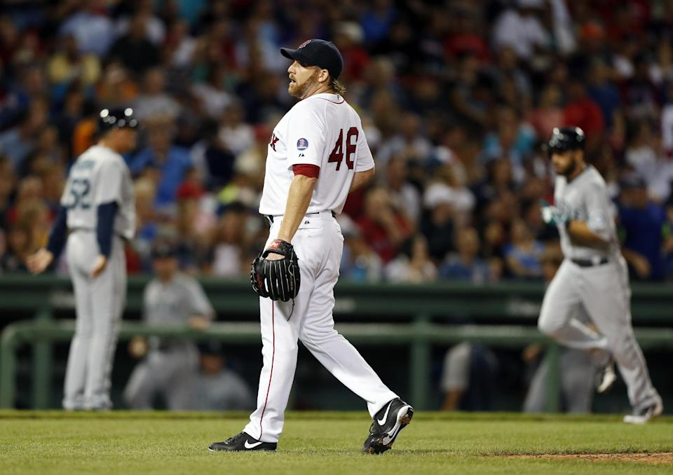 Boston Red Sox's Ryan Dempster (46) reacts after giving up a grand slam to Seattle Mariners' Henry Blanco, that also drove in Dustin Ackley, right, in the fifth inning of a baseball game in Boston, Thursday, Aug. 1, 2013. (AP Photo/Michael Dwyer)