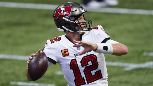 Tampa Bay Buccaneers quarterback Tom Brady (12) warms up before the first half of an NFL football game between the Atlanta Falcons and the Tampa Bay Buccaneers, Sunday, Dec. 20, 2020, in Atlanta. (AP Photo/John Bazemore)