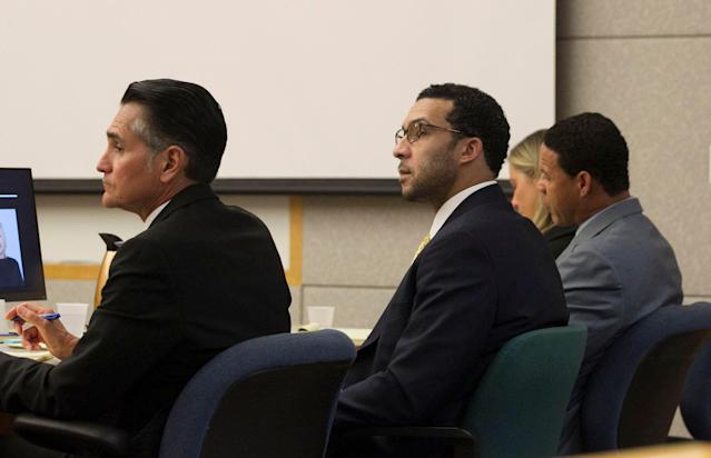 Former NFL football player Kellen Winslow Jr., center, sits with his attorneys Marc Carlo, left, and Brian Watkins, third from left, during his rape trial. (AP)