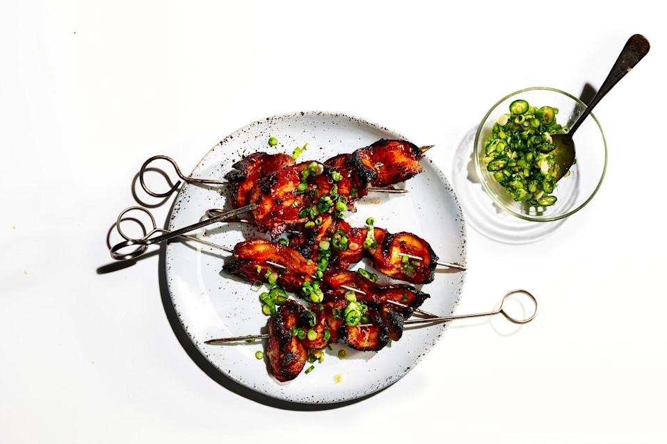 """We know it's tempting to rush the cooking, but keeping the bacon over indirect heat prevents flare ups and keeps the strips from burning. <a href=""""https://www.epicurious.com/recipes/food/views/sweet-and-spicy-grilled-bacon-kebabs-with-scallion-ginger-relish?mbid=synd_yahoo_rss"""" rel=""""nofollow noopener"""" target=""""_blank"""" data-ylk=""""slk:See recipe."""" class=""""link rapid-noclick-resp"""">See recipe.</a>"""