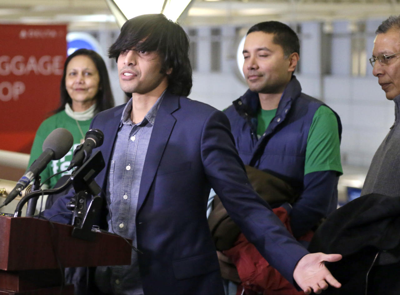 Shezanne Cassim, accompanied by his family, meets the media after he arrived at the Minneapolis-St. Paul International Airport, Thursday, Jan. 9, 2014 in Minneapolis after being held in a maximum security prison since June since June in the United Arab Emirates for a parody video that was posted online. (AP Photo/Jim Mone)
