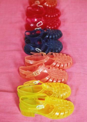 Photo by: Getty Images<br>Jelly shoes-<br>Available in a rainbow of colors, these made your feet sweat and get blisters, but they sure were fun! High-end designers like Louis Vuitton and Marc Jacobs still continue to harp on the nostalgia factor of these shoes each summer.