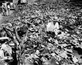 FILE - In this Sept. 17, 1945, file photo, a Japanese civilian salvages a piece of what was once a child's tricycle in Nagasaki, Japan. The city marks the 75th anniversary of the U.S. atomic bombing of Aug. 9, 1945. It was a second nuclear bomb dropped by the U.S. three days after it made the world's first atomic attack on Hiroshima. Japan surrendered on Aug. 15, ending World War II and its nearly a half-century aggression toward Asian neighbors. Dwindling survivors, whose average age exceeds 83, increasingly worry about passing their lessons on to younger generations. (AP Photo/Stanley Troutman, Pool, File)