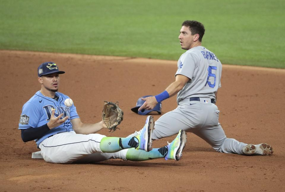 Dodgers catcher Austin Barnes is caught stealing after being tagged by Tampa Bay Rays shortstop Willy Adames.