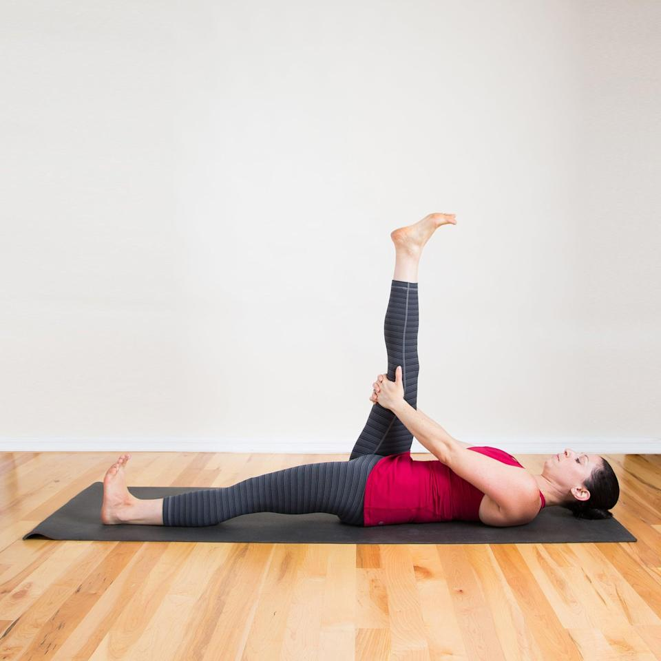 <ul> <li>Lying on your back, raise your right leg as high as you can, keeping your pelvis flat on the bed. Hold your lower thigh and encourage the leg to move toward your head. Flex your bottom foot to stretch your calf.</li> <li>Hold for 30 seconds, then switch sides. </li> </ul>