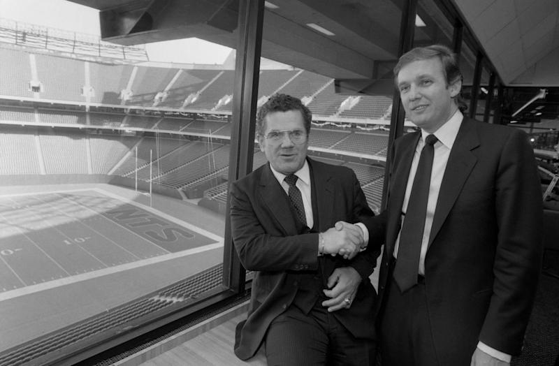 Walt Michaels shakes hands with New Jersey Generals'€™ owner Donald Trump at Giants Stadium after Trump named him as the USFL team€'s coach.