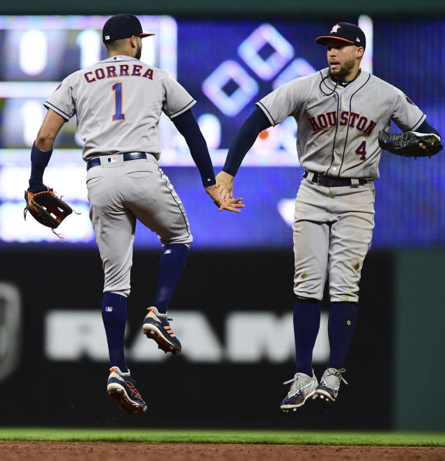 Houston Astros' George Springer, right, and Carlos Correa celebrate after the Astros defeated the Cleveland Indians 11-2 in a baseball game Friday, May 25, 2018, in Cleveland. (AP Photo/David Dermer)
