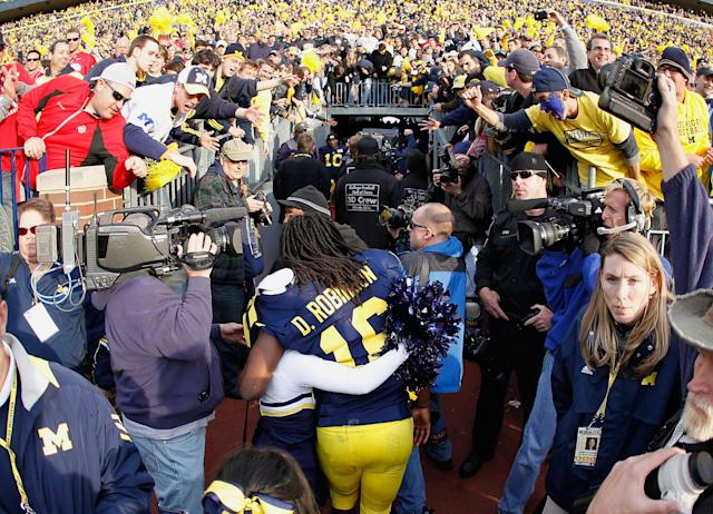 ANN ARBOR, MI - NOVEMBER 26: Denard Robinson #16 of the Michigan Wolverines leaves the field after beating Ohio State 40-34 at Michigan Stadium on November 26, 2011 in Ann Arbor, Michigan. (Photo by Gregory Shamus/Getty Images)