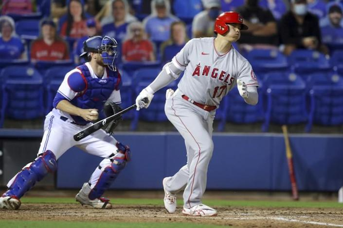 Los Angeles Angels' Shohei Ohtani strikes out in front of Toronto Blue Jays catcher Danny Jansen during the fifth inning of a baseball game Thursday, April 8, 2021, in Dunedin, Fla. The Angels won 7-5. (AP Photo/Mike Carlson)