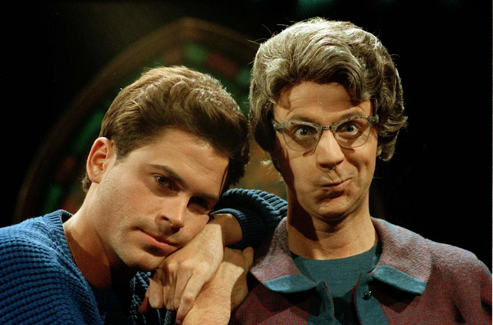 """Rob Lowe, left, and Dana Carvey as The Church Lady, appear together during rehearsals for NBC's """"Saturday Night Live,"""" March 15, 1990. (AP Photo/Frankie Ziths)"""