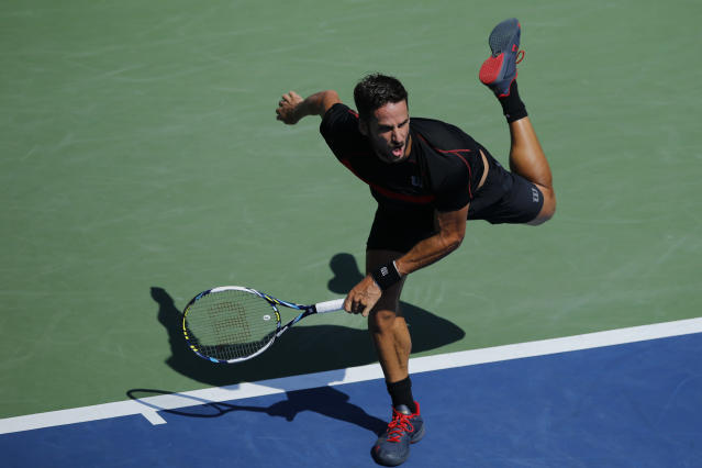 Feliciano Lopez of Spain serves to Ivan Dodig of Croatia during their US Open men's singles match, at the USTA Billie Jean King National Tennis Center in New York, on August 27, 2014 (AFP Photo/Kena Betancur)