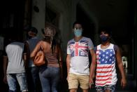 People wear T-shirts with Union Jack and a U.S. flag in downtown Havana