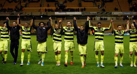 Britain Football Soccer - Wolverhampton Wanderers v Huddersfield Town - Sky Bet Championship - Molineux - 25/4/17Huddersfield Town players celebrate as they confirmed a playoff place after the matchMandatory Credit: Action Images / Andrew CouldridgeLivepic
