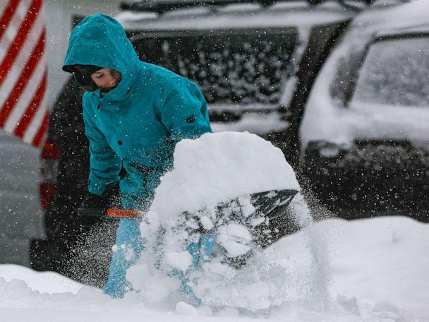 PHOTO: Jordan Dickman, 17, shovels some of the 11 inches of snow that fell on Nov. 26, 2019, in Denver. (Joe Mahoney/Getty Images)