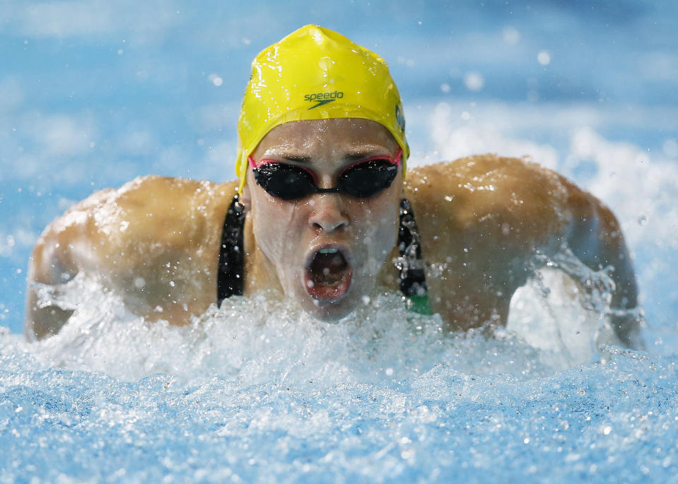 """FILE - In this July 28, 2014, file photo, Maddie Groves of Australia swims to win silver in the Women's 200m Butterfly final at the Tollcross International Swimming Centre during the Commonwealth Games 2014 in Glasgow, Scotland. Cody Simpson was dominating attention ahead of Australia's Olympic swimming trials, until Groves pulled out of the six-day meet following a series of social media posts condemning """"misogynistic perverts"""" in the sport. (AP Photo/Kirsty Wigglesworth, File)"""