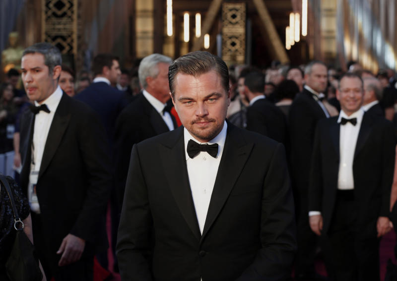 "Leonardo DiCaprio, nominated for Best Actor for his role in ""The Revenant"", wearing a Giorgio Armani tuxedo, arrives at the 88th Academy Awards in Hollywood, California"