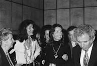 <p>Jackie and her sister Lee at a party with Norman Mailer (far right). </p>