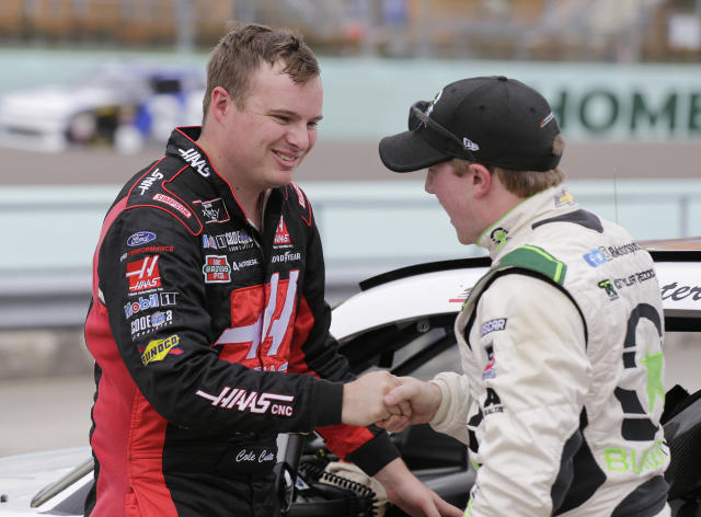 Cole Custer, left, is congratulated by Tyler Reddick after winning the pole position during qualifying for the NASCAR Xfinity Series auto race at Homestead-Miami Speedway in Homestead, Fla., Saturday, Nov. 17, 2018. (AP Photo/Terry Renna)