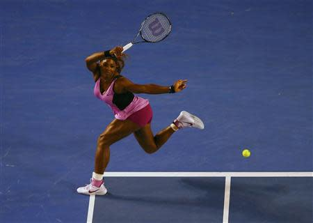 Serena Williams of the United States hits a return to Ashleigh Barty of Australia during their women's singles match at the Australian Open 2014 tennis tournament in Melbourne January 13, 2014. REUTERS/Petar Kujundzic