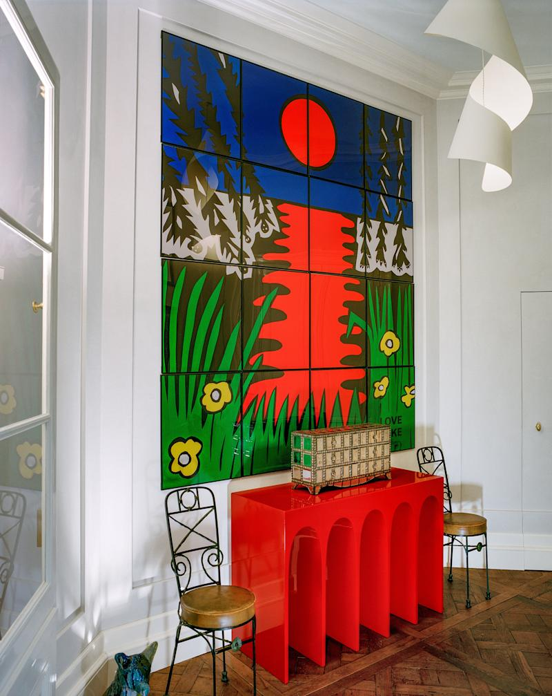 Diego Giacometti chairs flank an Hervé van der Straeten console in the entry. Gilbert and George painting; Man Ray pendant.
