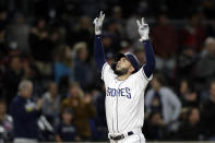 San Diego Padres' Eric Hosmer reacts after hitting a two-run home run during the sixth inning of the team's baseball game against the Arizona Diamondbacks, Tuesday, May 21, 2019, in San Diego. (AP Photo/Gregory Bull)