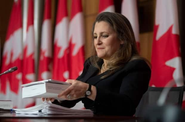 Deputy Prime Minister and Finance Minister Chrystia Freeland holds a copy of the budget as she packs up her papers at the end of a news conference in Ottawa on April 19. (Adrian Wyld/The Canadian Press - image credit)