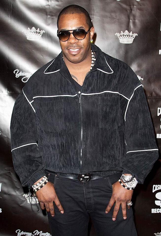 """Unfortunately, Busta Rhymes wasn't quite as dapper, and popped a rather feminine pose in lots of beads and bling at the fete. Regardless, he was thrilled that Lil Wayne was out of the slammer. """"It's gonna feel like us welcoming the return of a king,"""" he noted. John Parra/<a href=""""http://www.wireimage.com"""" target=""""new"""">WireImage.com</a> - November 7, 2010"""