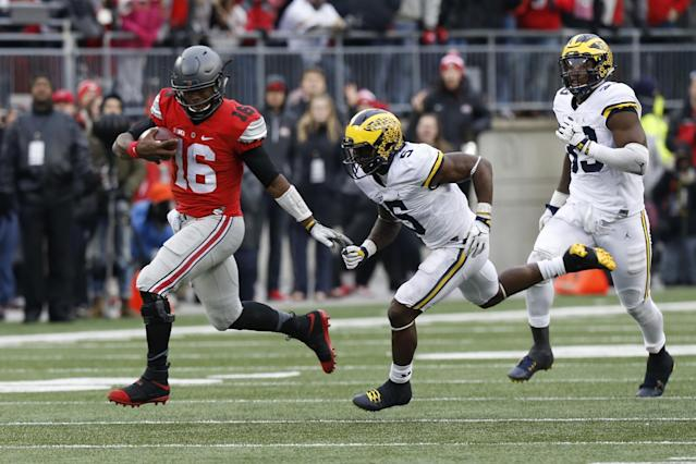 Michigan dropped from No. 3 to No. 5 in the AP Poll after losing to Ohio State, which stayed at No. 2. (AP Photo/Jay LaPrete)