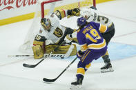 Vegas Golden Knights goaltender Marc-Andre Fleury (29) and defenseman Brayden McNabb block a shot by Los Angeles Kings right wing Alex Iafallo (19) during the first period of an NHL hockey game Wednesday, April 14, 2021, in Los Angeles. (AP Photo/Ashley Landis)