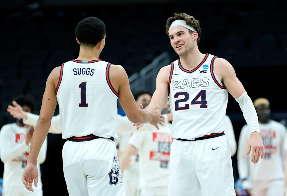 Jalen Suggs and Corey Kispert of the Gonzaga Bulldogs react after a play in the second half against the Norfolk State Spartans in the first round game of the 2021 NCAA Men's Basketball Tournament at Bankers Life Fieldhouse.