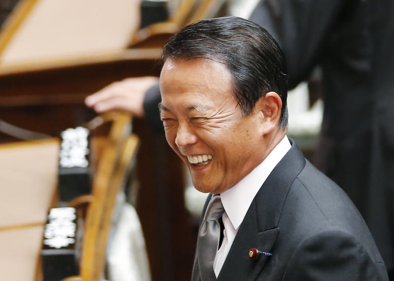 "Japanese Finance Minister Taro Aso laughs as he attends the extraordinary diet session at the Japanese parliament in Tokyo Friday, Aug. 2, 2013. Aso refused Friday to resign or apologize over remarks suggesting Japan should follow the Nazi example of how to change the country's constitution stealthily and without public debate. Following protests by neighboring countries and human rights activists, he ""retracted"" the comments on Thursday but refused to go further. (AP Photo/Koji Sasahara)"